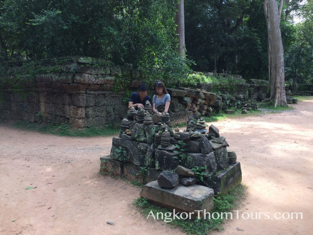 Visitors Stacking Stones Ta Prohm